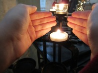 Lighting a candle in memory of pets passed